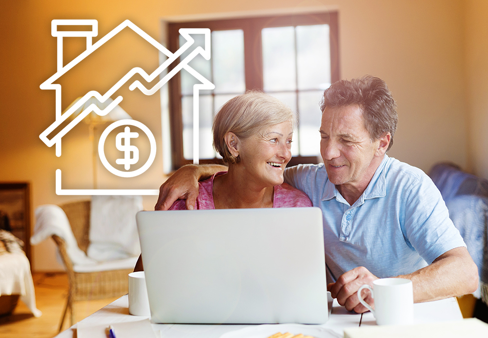 happy couple at laptop finding out what their home is worth
